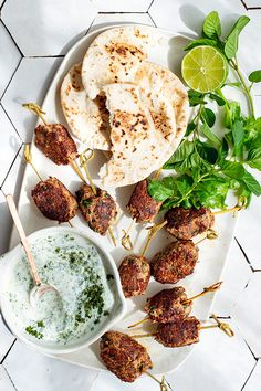 These lamb skewers are boldly flavoured with cumin, sumac and harissa. The accompanying dipping sauce is both spicy and cooling – fresh green chilli brings the heat and creamy yogurt balances it.