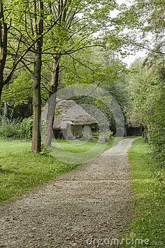 Country road and old wooden cottage in open-air museum in Nowy Sącz . Poland