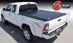 BAK Industries offers hard folding, retractable, hard rolling and rack integrated truck bed covers. View all of our products, get price, find a dealer or buy now. Rv Truck, Truck Mods, Trucks, 2014 Toyota Tacoma, Truck Bed Covers, Truck Bed Accessories, White Truck, Toyota Tundra