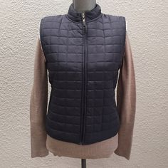 HOST PICK NWOT Blue Slate Quilted Vest New without tags, blue slate colored quilted vest by Daisy Fuentes. White soft lining is among the softest I've ever laid my hands on! Daisy Fuentes Jackets & Coats