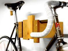 12 ways to store a bike in style -  wall-mounted-bike-rack-reclaimed-wood
