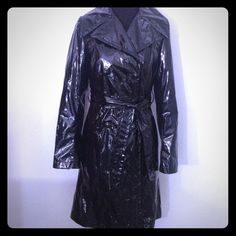 """Tahari Black Patent Leather Look Trench Coat XS Classic trench styling in a black shiny waterproof fabric. Great for the rain or to channel your inner Catwoman day or night. Measures 35"""" bust, 35"""" shoulder to hem. Lined in black satin fabric. In perfect condition. If you aren't already on #Poshmark, sign up with code HRTLC for $5 credit. #designer #fashion #shoes #jewelry"""