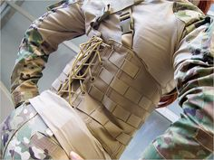 Ok, it's actually made for mil-sim airsoft gamers, but it still looks like the kind of thing that you would like.  Ghost Gear Ladies Corset Rig at Laylax | Popular Airsoft