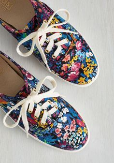 Define a lively day outdoors in the delightful decorum of these floral sneakers by Keds. Their painterly pattern of pink, yellow, and white flowers amid evening blue tones is an elegant choice by Liberty Art Fabrics, and their option of rope or classic laces threads through gold grommets with luxe loveliness!