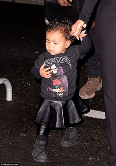 Mini fashionista: North wears a Yeezus jumper from her father's album and a leather skirt ...