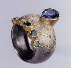 Ring | Michael Zobel.  Palladium pure gold, Sri Lanka sapphire, Columbian emerald and champagne coloured diamonds