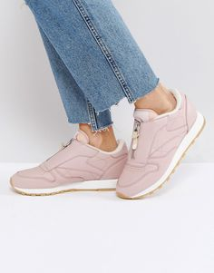 Buy it now. Reebok Classic Leather Zip Trainers In Pink - Pink. Trainers by Reebok, Leather upper, Zip fastening, Padded cuff for comfort, Perforated toe, Chunky sole, Moulded tread, Wipe with a damp cloth, 100% Real Leather Upper. Originally formed back in 1895, Reebok looks to its heritage to define its future as an undisputed streetwear pioneer. With high performance credentials, its iconic plimsolls and hi-top trainers are stamped with authenticity to look just as good kicking back or…