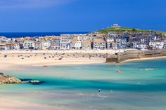 The pale blue harbor and charming waterfront buildings of St. Ives in Cornwall in England: 15 Stunningly Colorful Views You'll Only Encounter In Great Britain Cornwall England, St Ives Cornwall, Devon And Cornwall, West Cornwall, Yorkshire England, Yorkshire Dales, St Ives England, North Cornwall, Great Places