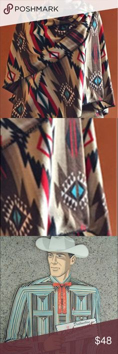 """Rockmount Native Pattern, Boho Fleece Poncho This is the PAINT poncho, with red, teal and brown. Soft, super cozy and flattering, this fleece poncho is made right here in Denver, by  Rockmount Ranch Wear. Sought after by actual cowgirls and movie stars alike, these amazing pieces are unique and beautiful. Great boho look for fall. It is 60"""" X 72"""". Premium 100% poly fleece with blanket stitch hem. Made in Denver, shipped to you, with cowgirl love!  No trades. I purchase for resale to pay my…"""