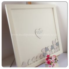 Drop top wedding guest book. Cream frame with a cherub patterned ...