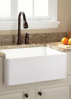 Farmhouse sinks are wonderful kitchen design elements. Place them with contrasting cabinets and clean countertops for a cottage-chic look that will never go out of style.