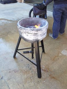Hand made blacksmith forge made from a fire truck brake drum and scrap metal.