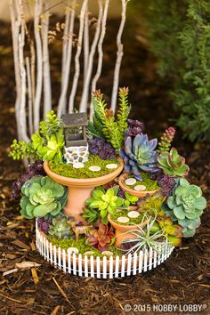 This mini fairy garden starts with pots and saucers in varied sizes–glue saucers to overturned pots for landing spots. Then go to town with miniatures (like fence and stepping stones), and faux greens.