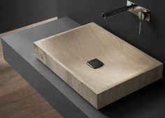 Super chic, this shallow basin mounted on a wall-mounted countertop creates a sophisticated, minimal washstand #minimal #washstand #basin