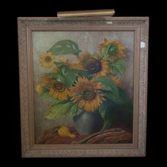 "Lot #215: Piet Cottaar (Dutch 1878-1950) Oil on Canvas This Oil on Canvas Painting Signed ""Piet Cottaar"" (Lower right) Portrays vibrant yellow Sunflowers in a Vase. Surrounding the Painting is a Two tone. White and beig wood frame. Includes Lighting Fixture.  CIRCA: 19th ORIGIN: Netherlands DIMENSIONS: 35″ x 39″"