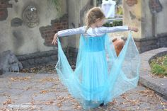 Lila joined the ranks of all the other Elsa's who swarmed the streets on Halloween. Luckily she had this bright metallic knit th. Frozen Costume, Costume Dress, Superman, Elsa, Dress Up, Flower Girl Dresses, Costumes, Knitting, Halloween