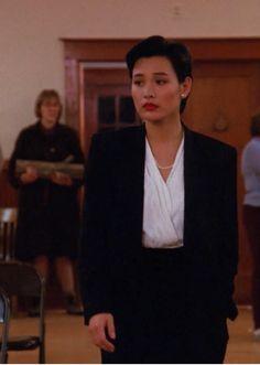 Joan Chen as Josie Packard wearing a slick short hairstyle
