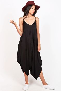 Super casual and comfortable jumpsuit for the trendy girl on the go. Harem bottom construction with a cropped length. Accessorize with a floppy hat and lace-up sandals. *Machine Wash Cold *95% Rayon 5