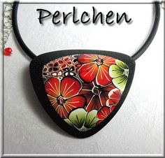 TEXTURE THE BLACK BACKGROUND AND LAY PENDANT ON TOP BUT BE CAREFUL OF AIR BUBBLES AND DISTORTION...............................Pendentif fleuri by perlchen67, via Flickr