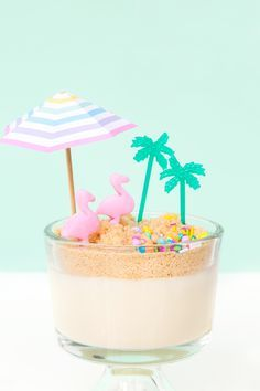 "How fun is this ""dirt"" pudding cup that gives off beach vibes? It will be a tasty treat on a summer day. Aloha Party, Luau Party, Cupcakes, Dirt Pudding Cups, Sand Pudding, Just Desserts, Dessert Recipes, Food Styling, Cake Pops"