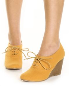 Yellow oxford wedges.