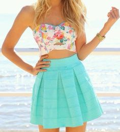 Multicolored floral bandeau paired with bright turquoise box pleated skater skirt in seersucker. Pretty. Style Planet #skater skirt #floral bandeau #seersucker skirt