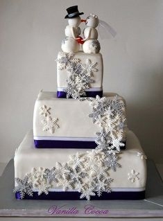 Snowflake wedding cake. Love the topper!! :)