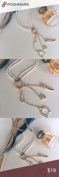 ✨{The Lady Luck} Pearl +Horeshoe + Horn Necklace ✨{The Lady Luck} ✨Double strand faux Pearls on gold plated chain. ✨Adorable horseshoe charm studded in diamond rhinestones✨Lucky Italian horn ✨Lace Heart ✨✨✨Great Christmas gift! ✨✨ ✨Make an offer on a bundle to save more & pay one shipping fee! Or ask me for a custom bundle when buying 3 or more items! ✨ Jewelry Necklaces