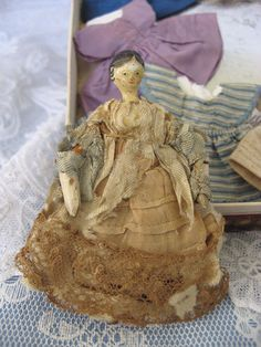 Fabulous Circa 1805-1820 Penny Wooden Doll with Trousseau