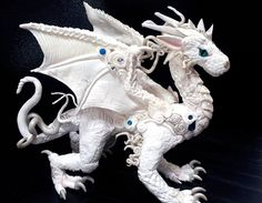 Beautiful dragon made with polymer clay and crystals and Swarovski details. 8 x 5 inches Aithusa, new dragon. Aithusa is a white dragon summoned from its egg by Merlin, who later saved Morgana's li...