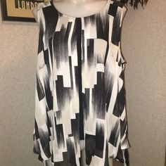 New Directions NWT SZ XL BlkIvory Sleeveless Top New Directions XL NWT Black/Ivory Scoop-neck Sleeveless Open Layered Short Front that Flows Perfectly With the Flowy Longer Back Hem Lines Inner Tank is Poly/Spandex & Outer is 100% Poly new directions Tops Camisoles