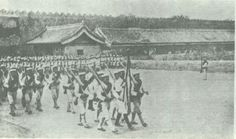Japanese troops march during the Boxer Protocol.