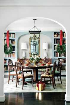 The repetitive shape of books on a shelf can act as a pattern in your dining room. Rows of books in built-in shelves make a beautiful patterned backdrop for the dining table in this space. These shelves were crafted from gypsum drywall, instead of wood, for a more modern profile.