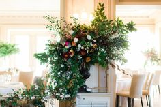 What an arrangement! Beautiful wedding flowers stealing the show at this reception   Julia Archibald Wedding Photography