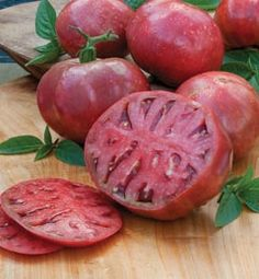 The Cherokee Purple was rediscovered by tomato grower Craig LeHoullier. LeHoullier claimed that it was more than 100 years old, originated with the Cherokee people. The Cherokee Purple tomato has a unique dusty rose color. The flavor of the tomato is ex Heirloom Tomatoes, Plantas Bonsai, Backyard Vegetable Gardens, Vegetable Garden Design, Potager Garden, Garden Plants, Buy Plants, Fruit Garden, Organic Gardening
