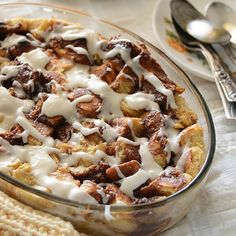 Cinnamon Bun Bread Pudding. Decadent and gooey with cinnamon swirls, custard-like bread pudding, and rich creamy frosting.