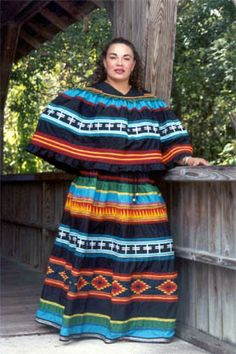 Michelle Chavis in a current Traditional Seminole Patchwork dress. The colors in this dress are from Tatanka's tribe (The Lumbee Nation) and represent a story about God! Native American Regalia, Native American Women, Native American Fashion, Seminole Indians, Cowboys And Indians, Seminole Patchwork, Patchwork Dress, Patchwork Designs, Traditional Dresses