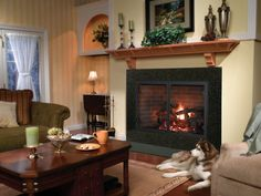 """Heatilator Icon Series Wood Fireplace in Icon 80 has 42""""w x 28 1/2 """"h viewable and requires 28 1/2"""" frame in. Wood fireplace  converted to gas with 24"""" gas log set.  For great room."""