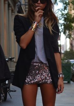 black blazer over gray top w/ sparkle shorts.