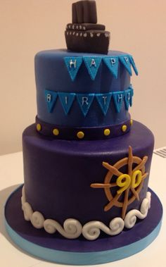 Naval cake with battleship, anchor, waves and flags for a gentleman's 90th birthday.