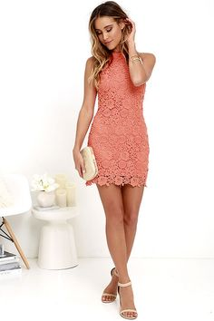 You'll be collecting notes from secret admirers right and left when you don the Love Poem Coral Orange Lace Dress! A lively pattern of floral lace creates an eye-catching overlay atop knit fabric. Halter neckline and darted sleeveless bodice transition into a chic, sheath skirt. Hidden back zipper with clasp.