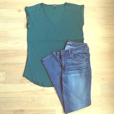 Short sleeve, V-neck blouse! This blouse is made of 96% polyester in a deep forest/emerald green color. Pairs wonderfully with khaki's or a light wash jean. Can be worn casually or dressed up! Express Tops Blouses