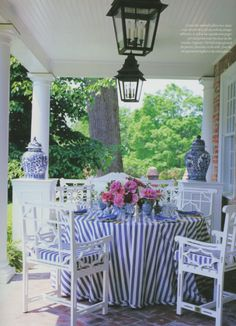 Casual Dining on The Veranda by Carolyne Roehm. Sunbrella blue & white striped fabric tablecloth is as practical as it is pretty. - The Enchanted Home Outdoor Rooms, Outdoor Living, Outdoor Decor, Estilo Tropical, Enchanted Home, Blue And White China, Decks And Porches, Front Porches, White Houses