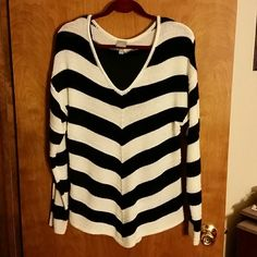 V STRIPE SWEATER **DROPPED PRICE**Black and white v stripe sweater.  Front and back come to a point.   Very cute and very comfy.   Long sleeve.  EUC. Vanity Sweaters V-Necks