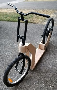 Working on this one for a few months now. Plywood and rough lumber plus old kids bike. Result is a kick scooter. Wooden Bicycle, Wood Bike, Scooter Bike, Kick Scooter, Kids Motorcycle, Kids Bike, Go Kart Plans, Lowrider Bicycle, Build A Bike