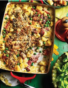 Cuddle up to this hearty gnocchi, ham and pea gratin