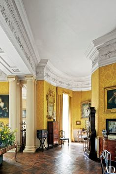 A Louis XV–style tall case clock, circa stands against a wall in the Yellow Drawing Room; Patrick's grandmother Anne Rosse, mother-in-law of England's Princess Margaret, hung the room with yellow damask in the