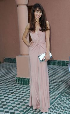 Olga Kurylenko wearing a Tara Jarmon Bal edition long pink dress  #nude #pink #model #actress #olgakurylenko #bal #dress