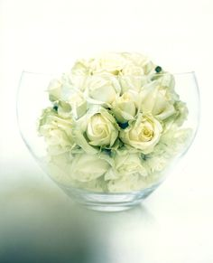 Avalanche roses in a ball for a wedding table centre