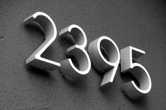 """House numbers from WestOn Letters. 6"""" deep Ribbon in Natural Satin Aluminum.       They come with a pattern, so you can eyeball placement before making it permanent. I ordered the spacers as well, to mount the numbers off the wall – it adds a nice shadow effect when it's sunny out. These puppies are the 6″ Deep Ribbon in Natural Satin Aluminum."""
